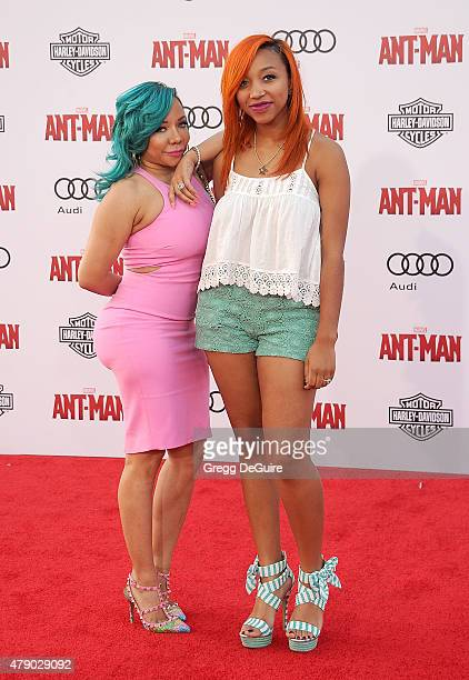 Tameka 'Tiny' CottleHarris and daughter Zonnique Pullins arrive at the premiere of Marvel Studios AntMan at Dolby Theatre on June 29 2015 in...