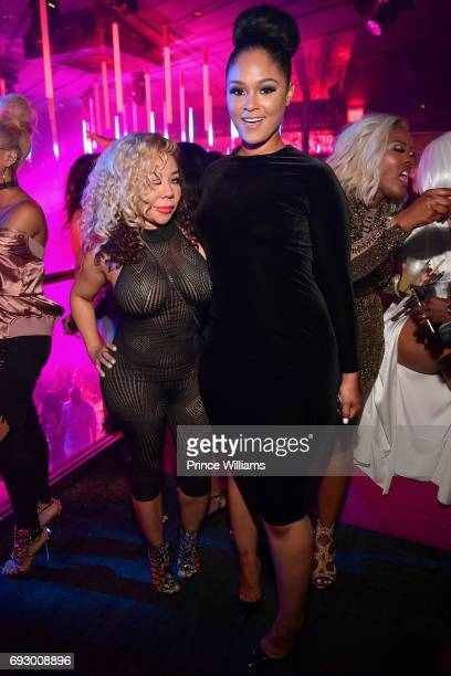 Tameka 'Tiny' Harris and Maliah Michel attend Pierre 'Pee' Thomas Birthday celebration at Gold Room at QC Grand Casino on June 6 2017 in Atlanta...