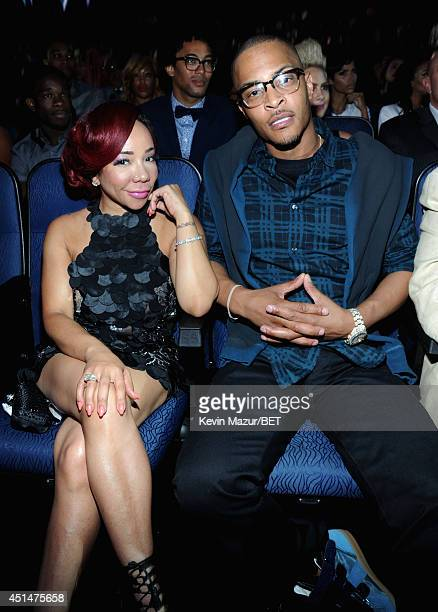 Tameka 'Tiny' Harris and TI attend the BET AWARDS '14 at Nokia Theatre LA LIVE on June 29 2014 in Los Angeles California