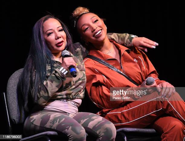"""Tameka """"Tiny"""" Harris and Zonnique Pullins speak onstage during 2019 Atlanta Ultimate Women's Expo at Cobb Galleria Centre on November 10, 2019 in..."""