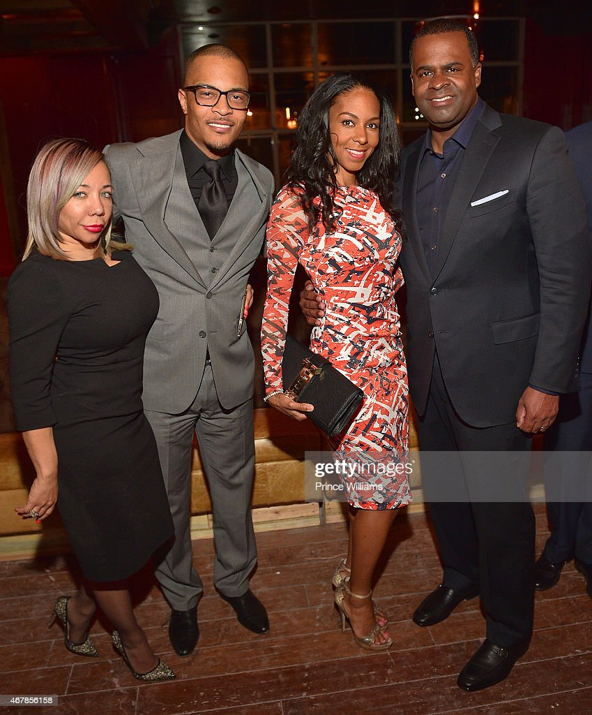 Tameka 'Tiny' Harris, Clifford 'T.I.' Harris, Sarah Elizabeth Reed and Kasim Reed attend 925 Scales ribbon cutting Ceremony at 925 Scales on March 27, 2015 in Atlanta, Georgia.