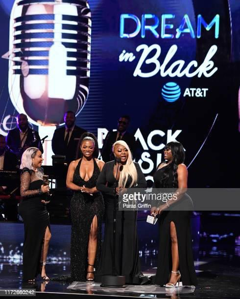 "Tameka ""Tiny"" Harris, Kandi Burruss, LaTocha Scott and Tamika Scott of Xscape onstage during 2019 Black Music Honors at Cobb Energy Performing Arts..."