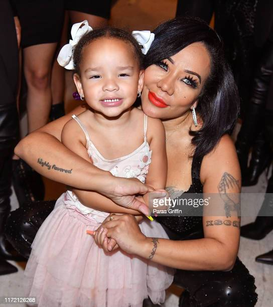 """Tameka """"Tiny"""" Harris poses with her daughter Heiress Diana Harris backstage during Majic 107.5 After Dark at City Winery on September 03, 2019 in..."""
