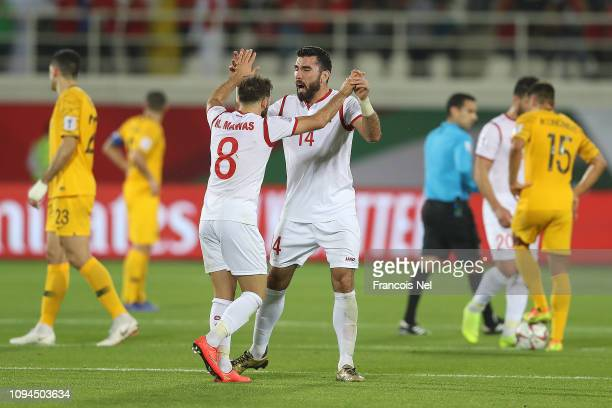 Tamer Hag Mohamad and Mahmoud Almawas of Syria celebrate the equalising goal during the AFC Asian Cup Group B match between Australia and Syria at...