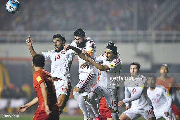 XI'AN CHINA OCTOBER 06 Tamer Haj Mohamad Ahmad Al Salih and Alaa Al Shbli of Syria jump for the ball during the 2018 World Cup qualifying group A...