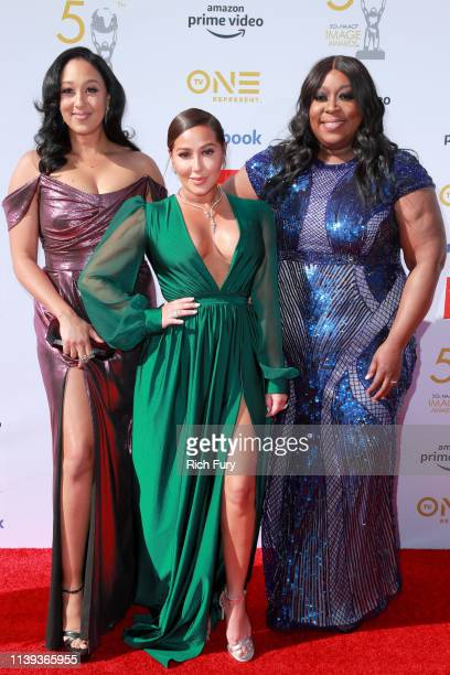 Tamera Mowry Adrienne Bailon and Loni Love attend the 50th NAACP Image Awards at Dolby Theatre on March 30 2019 in Hollywood California
