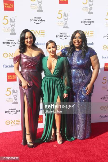 Tamera MowryHousley Adrienne Bailon and Loni Love attend the 50th NAACP Image Awards at Dolby Theatre on March 30 2019 in Hollywood California