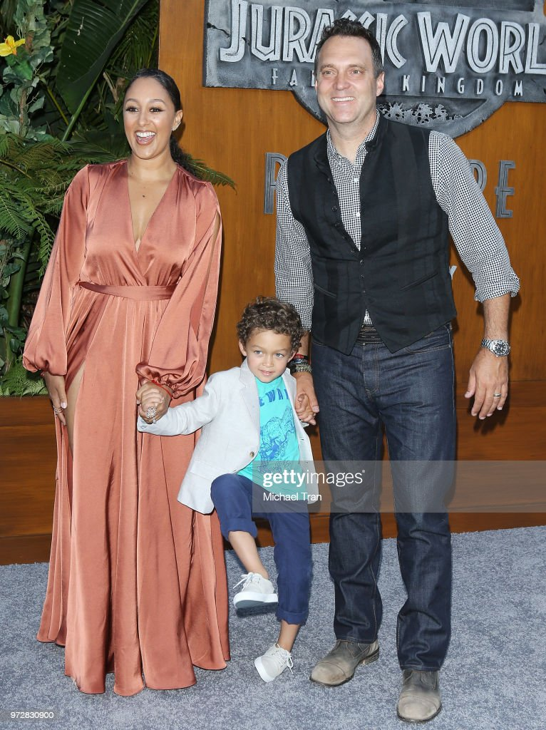 Tamera Mowry-Housley and her family arrive to the Los Angeles premiere of Universal Pictures and Amblin Entertainment's 'Jurassic World: Fallen Kingdom' held at Walt Disney Concert Hall on June 12, 2018 in Los Angeles, California.