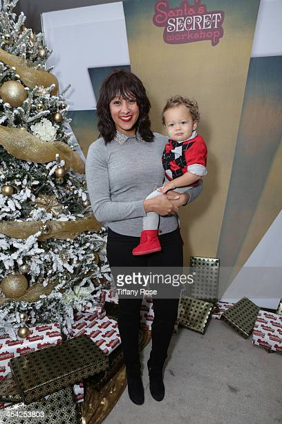 Tamera MowryHousley and her son Aden attend the 3rd Annual Santa's Secret Workshop Benefiting LA Family Housing at Andaz Hotel on December 7 2013 in...