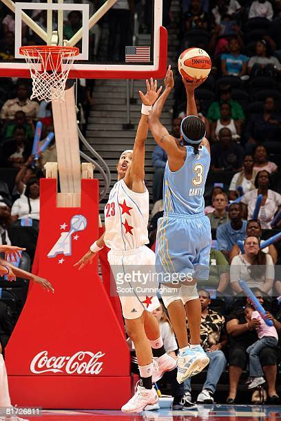 Tamera Young of the Atlanta Dream challenges the shot by Dominique Canty of the Chicago Sky during the WNBA game on June 6 2008 at Philips Arena in...