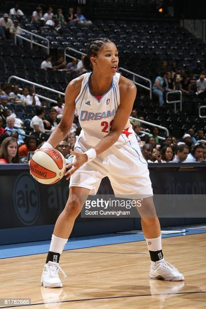 Tamera Young of the Atlanta Dream looks to pass the ball against the San Antonio Silver Stars during the WNBA game on June 18 2008 at Philips Arena...