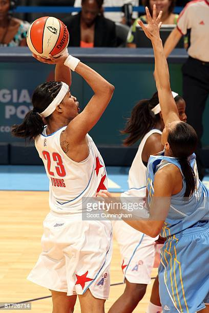 Tamera Young of the Atlanta Dream shoots over Armintie Price of the Chicago Sky during the WNBA game on June 6 2008 at Philips Arena in Atlanta...