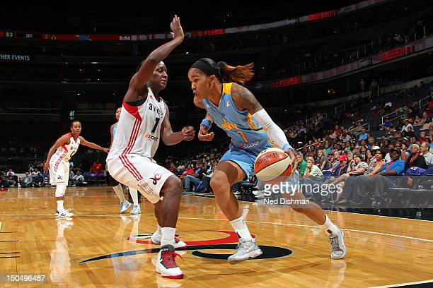 Tamera Young of the Chicago Sky drives against Crystal Langhorne of the Washington Mystics at the Verizon Center on August 19 2012 in Washington DC...
