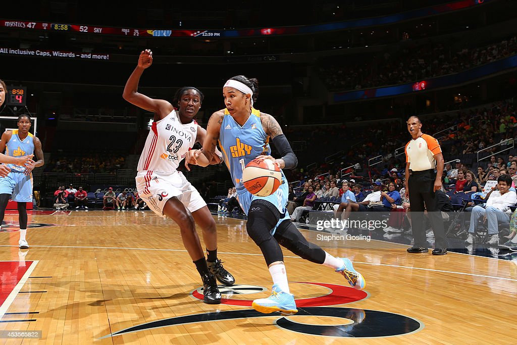 Tamera Young #1 of the Chicago Sky drives against Kalana Greene #23 of the Washington Mystics at the Verizon Center on August 13, 2014 in Washington, DC.