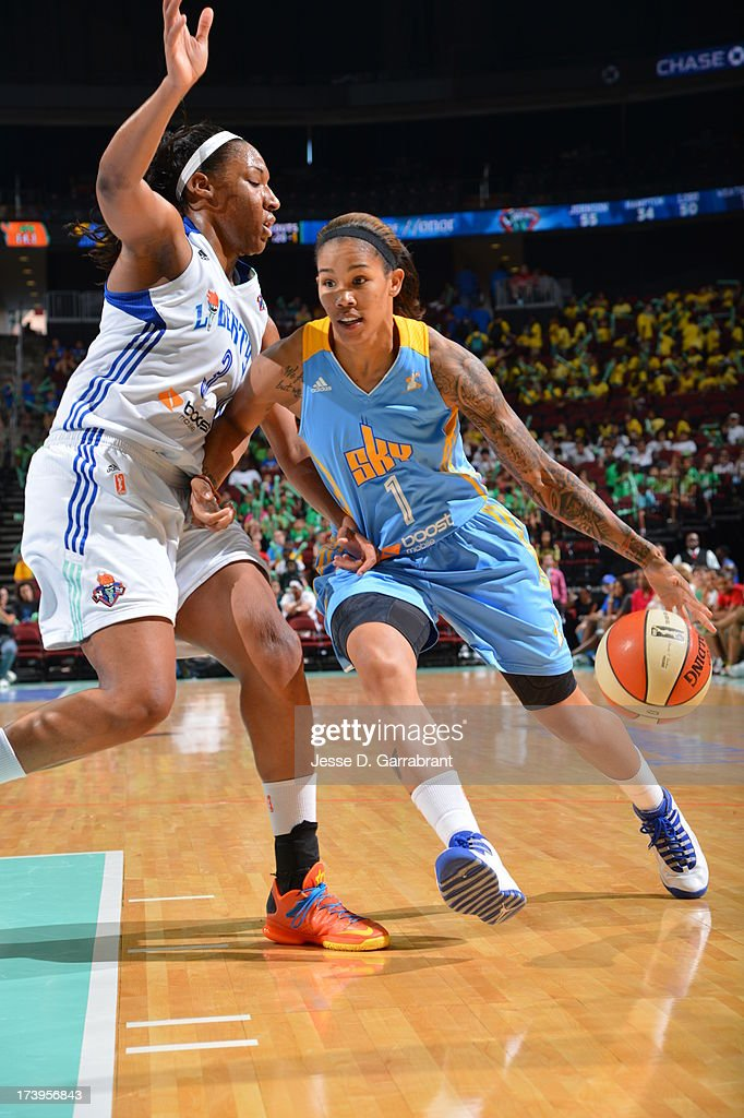Tamera Young #1 of the Chicago Sky drives against Kelsey Bone #3 of the New York Liberty during the game on July 18, 2013 at Prudential Center in Newark, New Jersey.