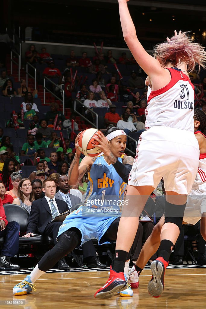 Tamera Young #1 of the Chicago Sky drives against Stefanie Dolson #31 of the Washington Mystics at the Verizon Center on August 13, 2014 in Washington, DC.