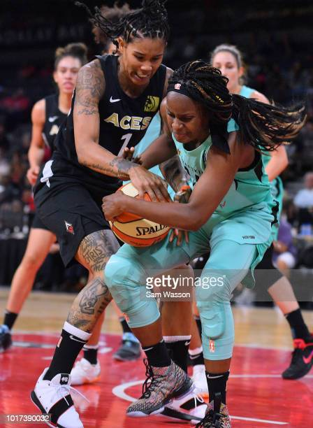 Tamera Young of the Las Vegas Aces and Sugar Rodgers of the New York Liberty fight for a loose ball during their game at the Mandalay Bay Events...