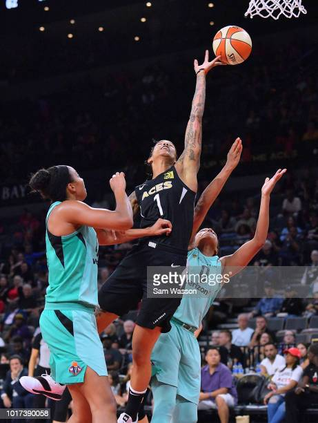 Tamera Young of the Las Vegas Aces battles for a rebound against Kiah Stokes and Marissa Coleman of the New York Liberty during their game at the...