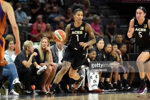 Tamera Young of the Las Vegas Aces handles the ball against the Phoenix Mercury on August 1 2018 at the Mandalay Bay Events Center in Las Vegas...