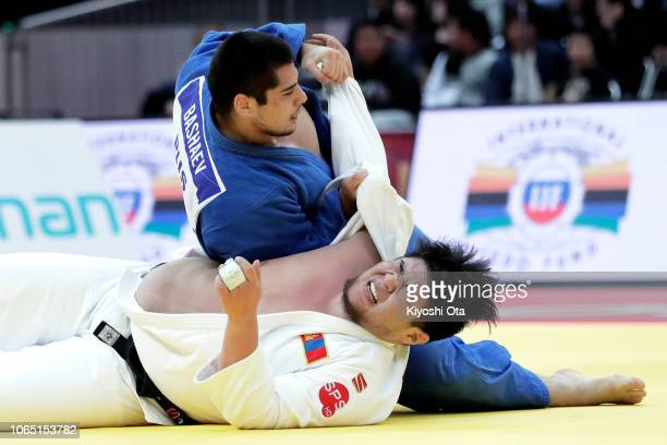 Tamerlan Bashaev of Russia competes against Duurenbayar Ulziibayar of Mongolia in the Men's 100kg bronze medal match on day three of the Grand Slam...