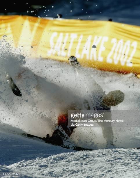 Tami Bradley, of the Canada, wipes out in the finals of the Women's Moguls of the 2002 Winter Olympics at Deer Valley resort in Park City, Utah. She...