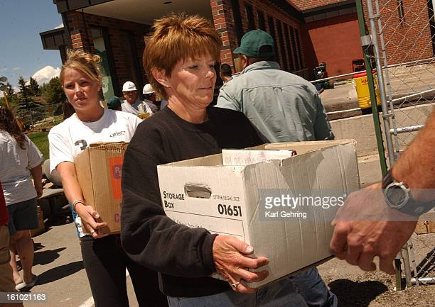 Tami Cherrington <cq> center and about a hundred other volunteers helped remove library books from the Grand County Library building Thursday...