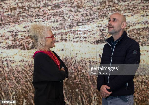 """Tami Katz-Freiman curator for the Israeli pavilion and artist Gal Weinstein pose for a picture at the press preview of the exhibition """"Sun Stand..."""