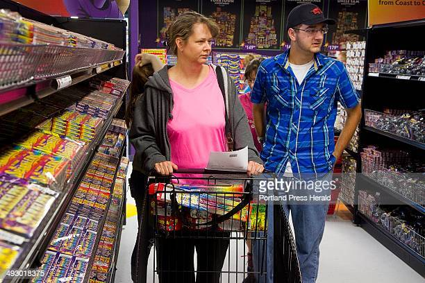 Tami Langrell and Caleb Langrell of Callahan Fla stock up with fireworks for a holiday celebration with family in Lyman at Phantom Fireworks in...