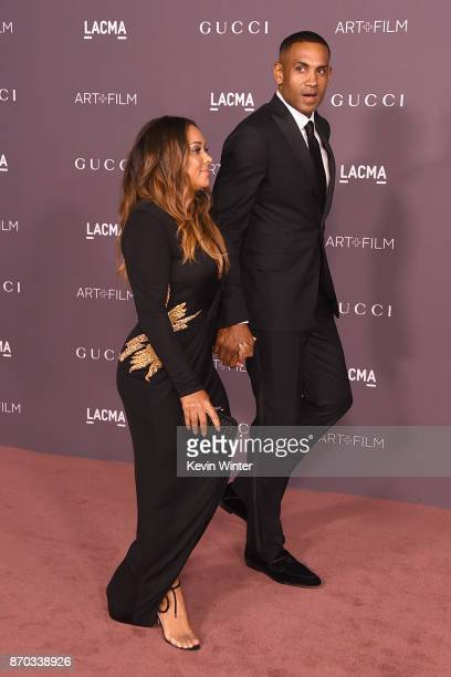 Tamia and Grant Hill attend the 2017 LACMA Art Film Gala Honoring Mark Bradford And George Lucas at LACMA on November 4 2017 in Los Angeles California
