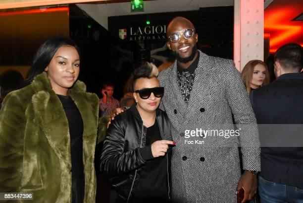 Tamia designer Nadia Toure and footballer Momo Sissoko attend 'Les Diamants de L'Orient' Nadia Toure Streetwear Fashion Show at VIP Room Theater Club...