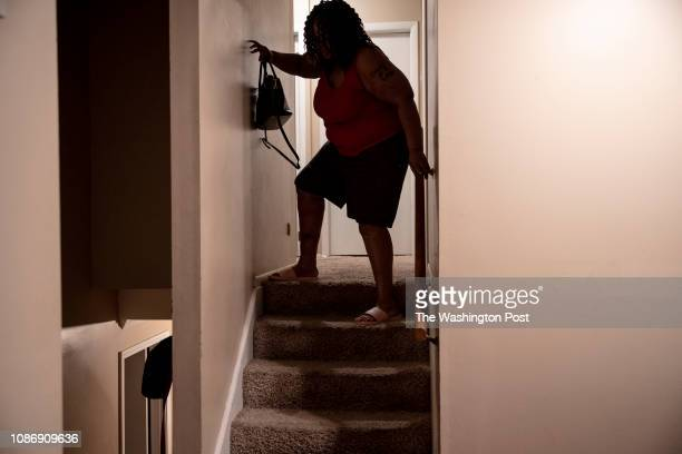 Tamika Arnold Capone's makes her way slowly down the stairs on her way to drop off her daughter's apron at work She was hit by a drunk driver in 2011...