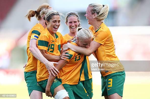 Tamika Butt of Australia celebrates scoring a goal with team matesduring the match between the Australian Matildas and China PR at WIN Stadium on...