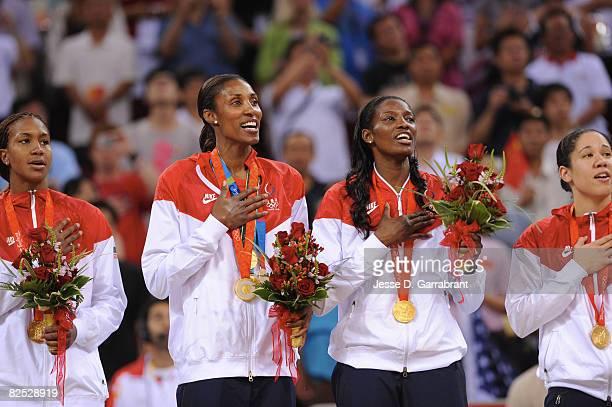 Tamika Catchings, Lisa Leslie, DeLisha Milton-Jones and Kara Lawson of the U.S. Women's Senior National Team celebrate after winning the gold medal...