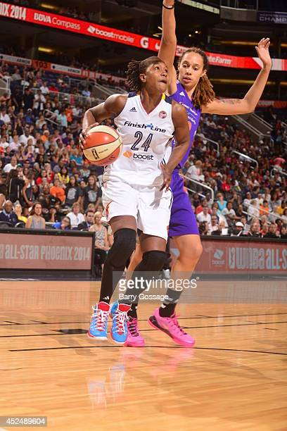 Tamika Catchings of the Eastern Conference AllStars dribbles against Brittney Griner of the Western Conference AllStars during the 2014 Boost Mobile...