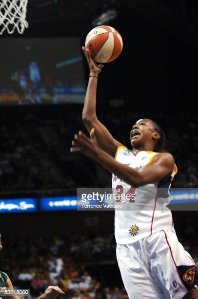 Tamika Catchings of the Eastern Conference AllStars drives to the basket for a layup against the Western Conference AllStars during the 2005 WNBA...