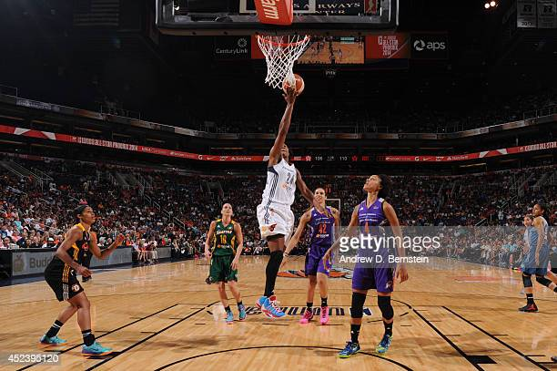 Tamika Catchings of the Eastern Conference AllStars shoots during the 2014 Boost Mobile WNBA AllStar Game on July 19 2014 at US Airways Center in...