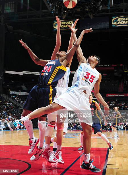 Tamika Catchings of the Indiana Fever battles for a rebound against Angel McCoughtry of the Atlanta Dream at Philips Arena on May 27 2012 in Atlanta...
