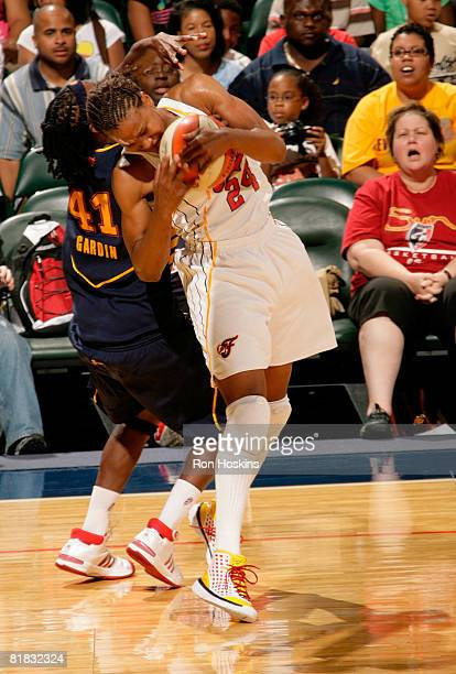 Tamika Catchings of the Indiana Fever battles Kerri Gardin of the Connecticut Sun at Conseco Fieldhouse on July 5 2008 in Indianapolis Indiana The...