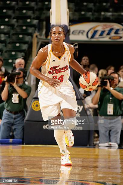 Tamika Catchings of the Indiana Fever brings the ball upcourt during the WNBA game against the Connecticut Sun on June 22 2007 at Conseco Fieldhouse...