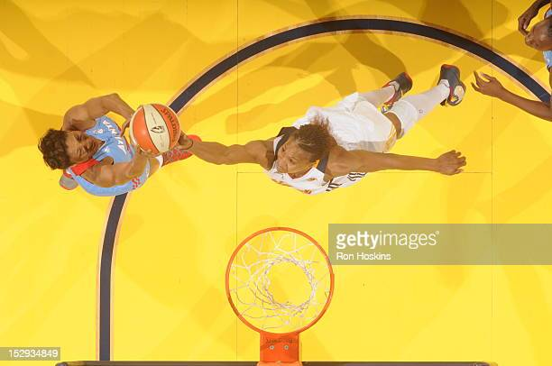 Tamika Catchings of the Indiana Fever defends Angel McCoughtry of the Atlanta Dream during Game One of the East Conference SemiFinals at Banker's...
