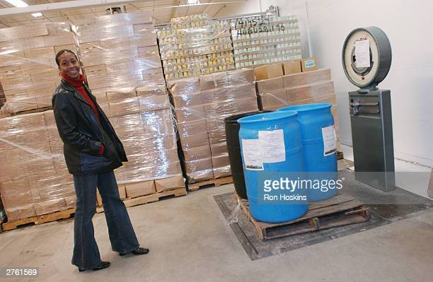 Tamika Catchings of the Indiana Fever delivers canned goods November 25 2003 at Gleaners Food Bank in Indianapolis Indiana The canned goods were...