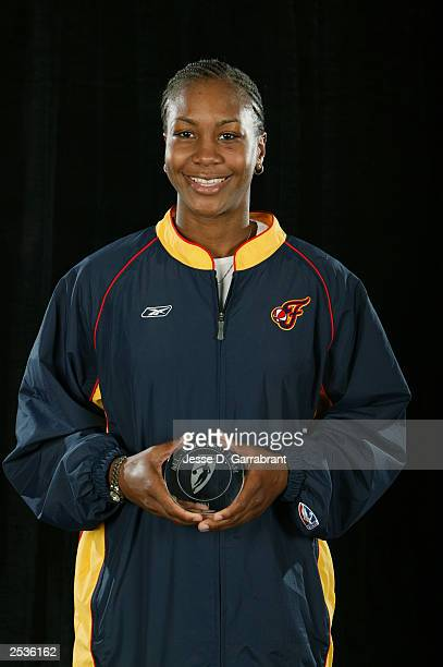 Tamika Catchings of the Indiana Fever displays her AllWNBA First Team award at game two of the 2003 WNBA Finals between Los Angeles Sparks and the...