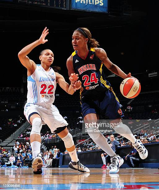 Tamika Catchings of the Indiana Fever drives against Armintie Price of the Atlanta Dream at Philips Arena on August 30 2011 in Atlanta Georgia NOTE...