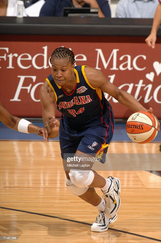 Tamika Catchings #24 of the Indiana Fever drives during a game against the Washington Mystics at MCI Center on June 27, 2006 in Washington, D.C. The Fever won 74-67.