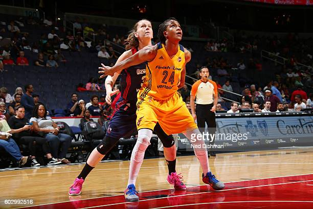 Tamika Catchings of the Indiana Fever fights for position against Emma Meesseman of the Washington Mystics on September 11 2016 at the Verizon Center...