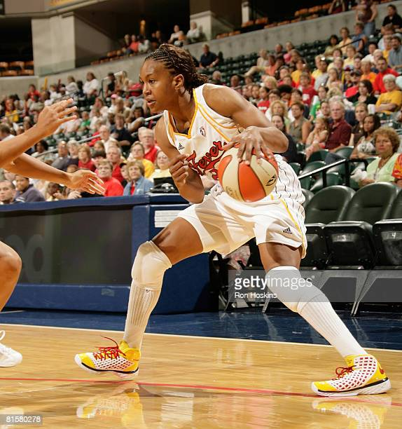 Tamika Catchings of the Indiana Fever makes a move on a San Antonio Silver Stars defender at Conseco Fieldhouse on June 15 2008 in Indianapolis...