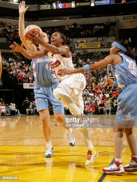 Tamika Catchings of the Indiana Fever moves on Katie Feenstra and Betty Lennox of the Atlanta Dream at Conseco Fieldhouse on August 30 2008 in...