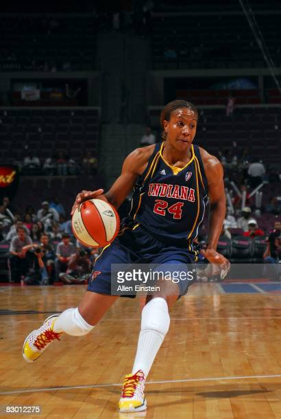 Tamika Catchings of the Indiana Fever moves the ball against the Detroit Shock in Game Three of the Eastern Conference Semifinals during the 2008...