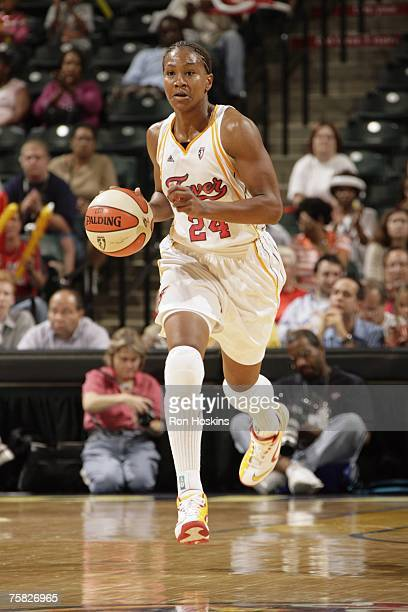 Tamika Catchings # of the Indiana Fever moves the ball up court during a WNBA game against the Detroit Shock at Conseco Fieldhouse on July 20 2007 in...