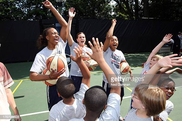 Tamika Catchings of the Indiana Fever participates in a clinic on the White House basketball court during a visit to the White House to recognize the...